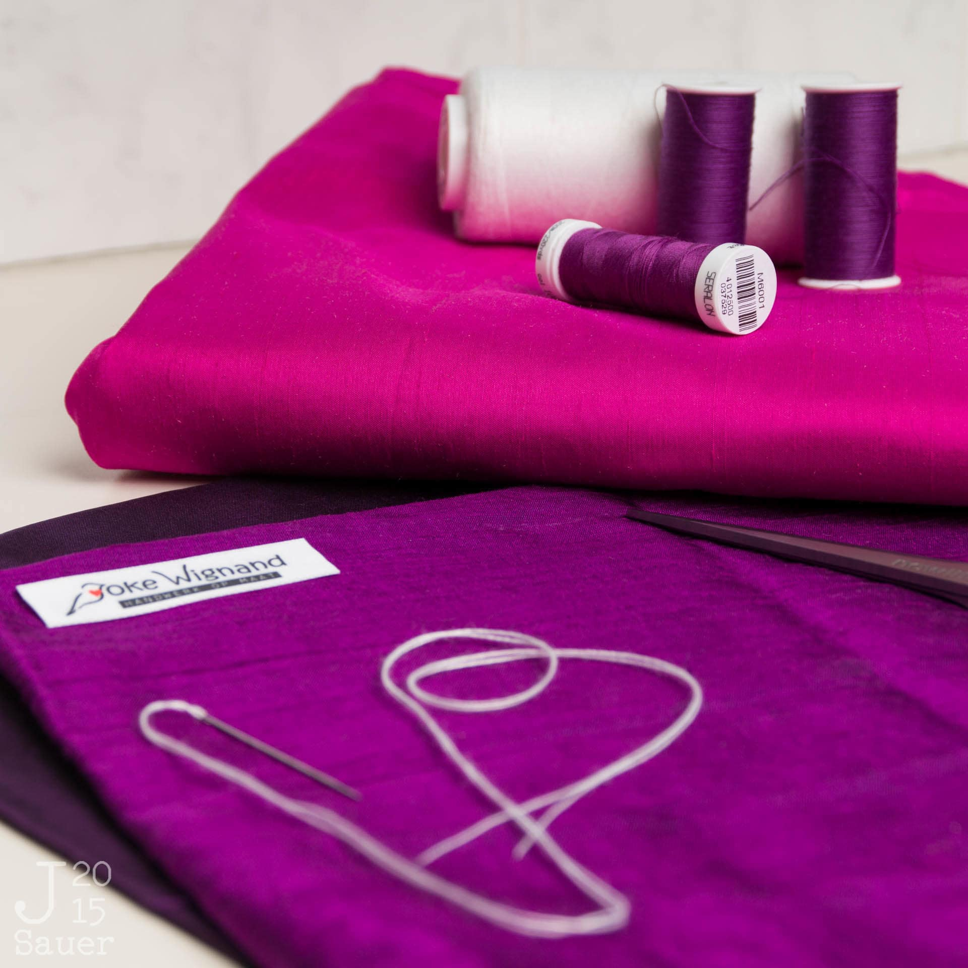Roze en paarse stoffen en garen